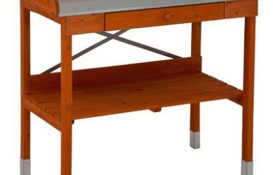 Cypress wood potting bench with metal top for succulents or other gardening chores.