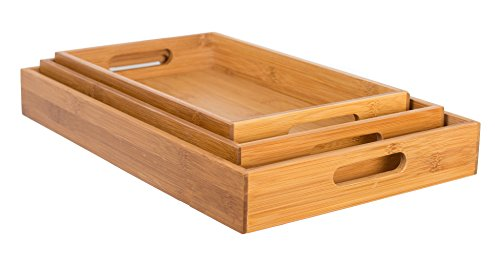 Set of 3 nested bamboo trays of graduated sizes with cut out handles.
